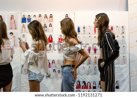 MILAN, ITALY - SEPTEMBER 20: Gorgeous models pose in the backstage just before Genny show during Milan Women's Fashion Week on SEPTEMBER 20, 2018 in Milan. #1192131271