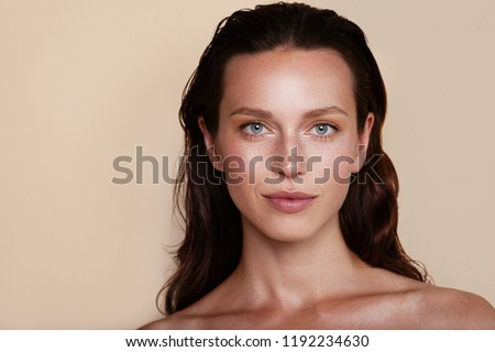 Beauty woman portrait. Beautiful spa model girl with perfect fresh clean skin. Youth and skin care concept. Beige background. Nude makeup #1192234630