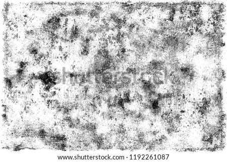 The texture of cracks, chips, scuffs on a white background. Monochrome gloomy grunge background. Pattern of spots, dust, dirt on old surface #1192261087