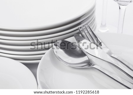 Set of clean tableware on white background, closeup. Washing dishes #1192285618