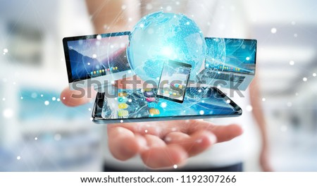 Businessman connecting tech devices and icons applications with each other 3D rendering Royalty-Free Stock Photo #1192307266
