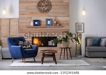 Cozy furnished apartment with niche in wooden wall and armchair. Interior design #1192341688
