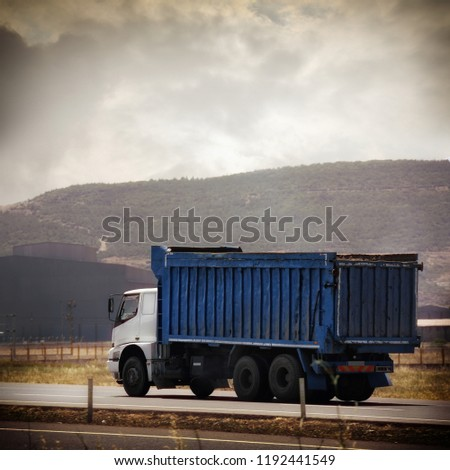 an image of a truck on the road #1192441549