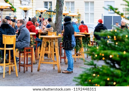 Berlin, Germany - December 9, 2017: People at Christmas Market street cafe on Charlottenburg Palace in Winter Berlin, Germany. Advent Fair Decoration and Stalls with Crafts Items on the Bazaar. #1192448311