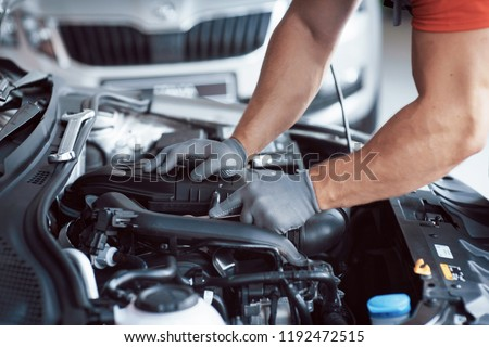 Auto mechanic working in garage. Repair service. #1192472515