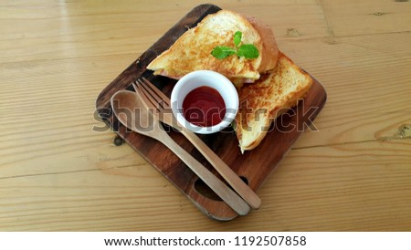 Cheese and ham toasted #1192507858