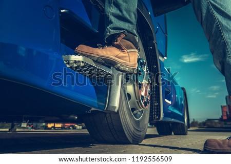Truck Driver Concept. Driver Getting Into the Semi. Legs Closeup. #1192556509