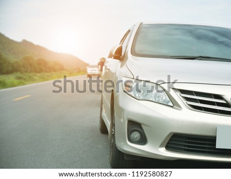 Car parked on road and Small passenger car seat on the road used for daily trips #1192580827