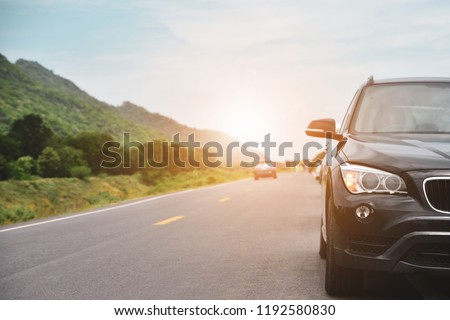 Car parked on road and Small passenger car seat on the road used for daily trips #1192580830