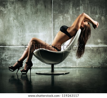 Young sexy woman sitting on chair. #119263117