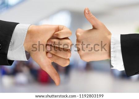 Human hands showing agree sign Versus disagree #1192803199