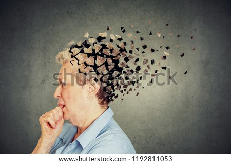 Memory loss due to dementia. Senior woman losing parts of head feeling confused as symbol of decreased mind function. #1192811053