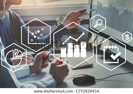 business analytics intelligence concept, financial charts to analyze profit and finance performance of company Royalty-Free Stock Photo #1192828456