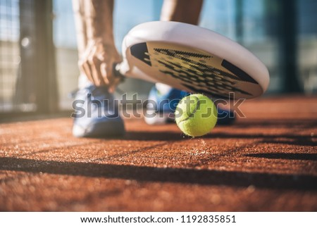 Sportsman playing padel game #1192835851