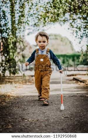 Blind or Visually Impaired Child/Kid/Toddler/Preschooler/Boy Walking Through Neighborhood with Long White Cane, #3 #1192950868