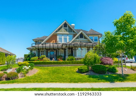 Big custom made luxury house with nicely landscaped and trimmed front yard in the suburbs of Vancouver, Canada. #1192963333