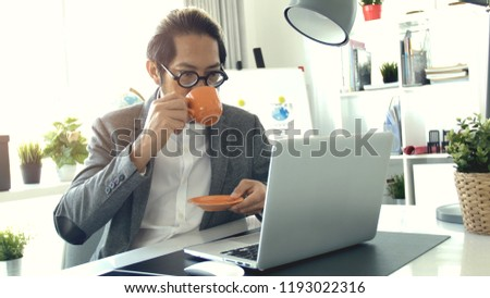 Businessman working on laptop computer in the office, Asian business man wearing eyeglass in office. #1193022316