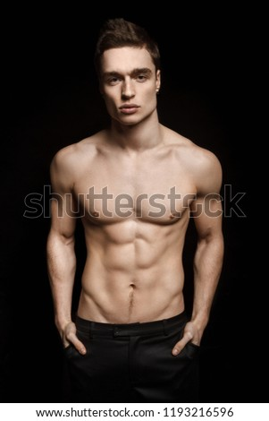 Handsome sport sexy stripped guy portrait on isolated black background #1193216596