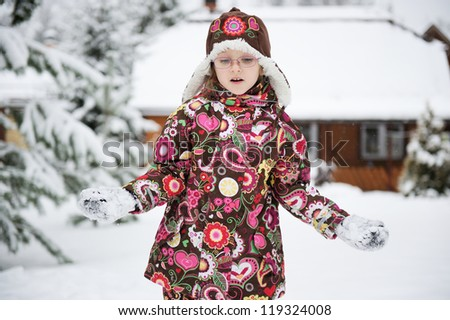Winter portrait of playful child girl in colorful warm clothes #119324008