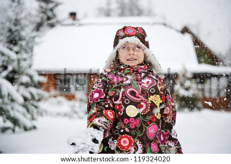 Winter portrait of playful child girl in colorful warm clothes #119324020