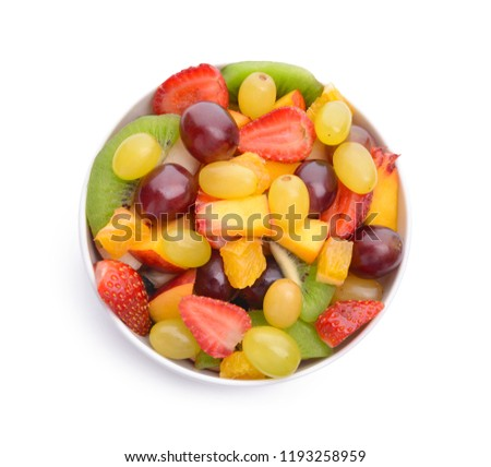 Bowl with delicious fruit salad on white background #1193258959