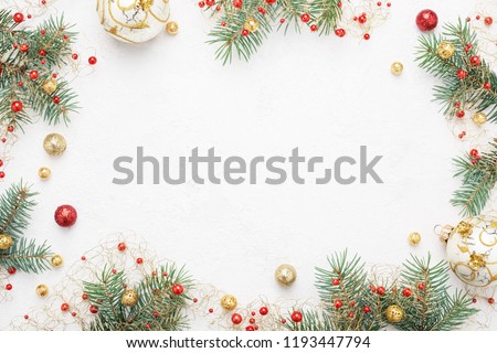 Bright Christmas frame of spruce, red & gold christmas decorations on white background. Copy space. Winter holidays, New Year. #1193447794