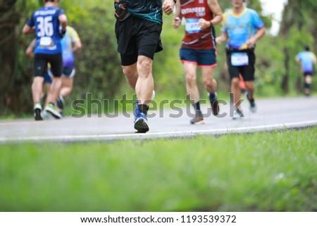 Group of people running race marathon #1193539372