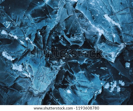 Splits in ice. Сool background. Ice cracks. Rock texture. Ice texture. Rough structure mineral. Stone background. #1193608780