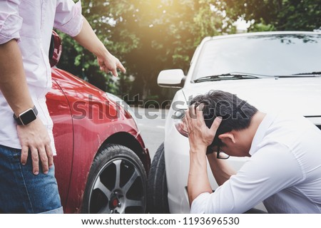 Two drivers man arguing after a car traffic accident collision, Traffic Accident and insurance concept. #1193696530