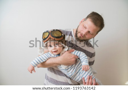 father and son play dressed as a pilot #1193763142