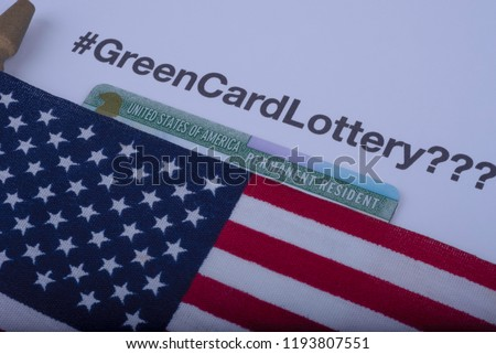 Hashtag of Green card Lottery, green permanent resident card covered Flag of USA (American) on white background. Diversity Visa Lottery concept.  #1193807551
