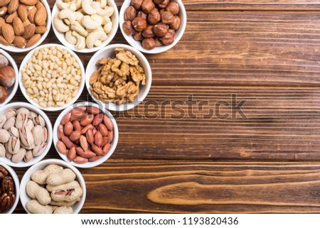 Mix of nuts : Pistachios, almonds , walnuts , pine nut , hazelnuts and cashew . Snack in bowl backgrond #1193820436