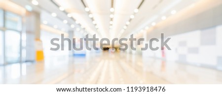Blurred bokeh panoramic banner background of exhibition hall or convention center hallway. Business trade show event, modern interior architecture, or commercial tradeshow conference seminar concept Royalty-Free Stock Photo #1193918476