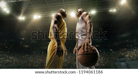 Black basketball players on big professional arena before the game. Two teams. Players collided face to face. Player holds a ball #1194061186