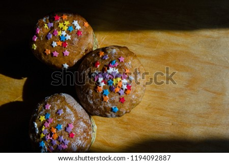 Easter homemade buns with colored stars #1194092887