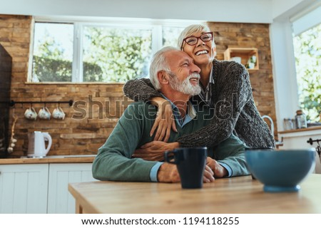 Mature woman hugging her husband #1194118255