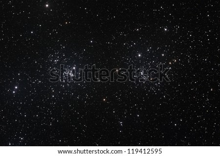 Starfield with The Double Cluster (Cadwell 14) in the constellation of Perseus formed by two open clusters NGC 884 and NGC 869. Royalty-Free Stock Photo #119412595