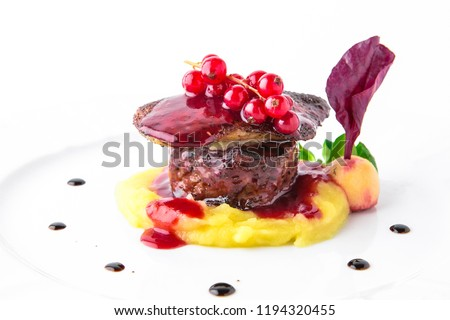 Foie gras with beef minion, mashed asparagus and  artichoke, with berry sauce. Banquet festive dishes. Fine dining restaurant menu. White background.