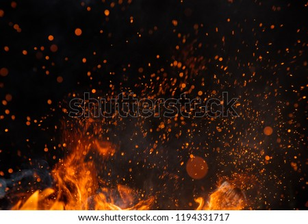 Fire sparks particles with flames isolated on black background. Very high resolution