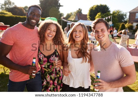Portrait Of Friends Enjoying Drinks At Summer Garden Fete #1194347788
