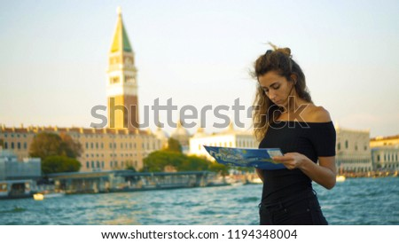 girl exploring the map and seeing the sights in travel #1194348004
