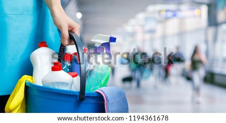 Cleaning lady with cleaning products on blurred background. #1194361678