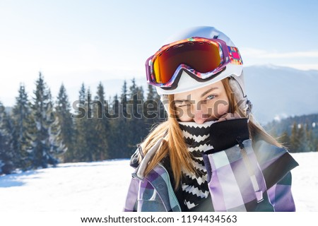 Skier girl on the background of high mountain Carpathians in Ukraine. Winter sport. #1194434563