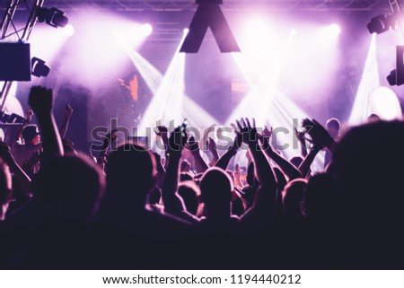 Crowd at a concert with hands up #1194440212