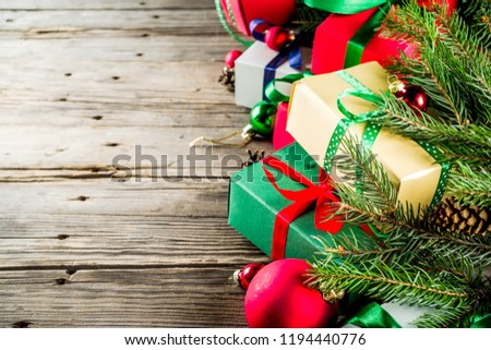 Christmas festive background with decorations and colorful gift boxes on wooden board #1194440776