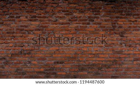 The texture of the brick is red. Background of empty brick basement wall. #1194487600