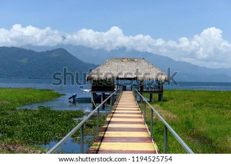 Thatched boathouse, Lake Yojoa, Honduras #1194525754