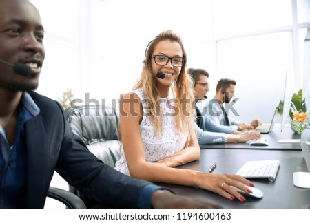 young business woman sitting at table in call center #1194600463