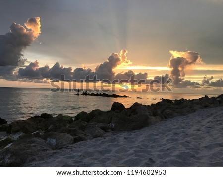 Heavenly ocean sunsets #1194602953