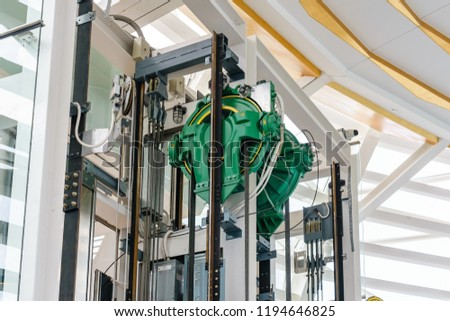 Elevator engine room with elevator motor. Motor driven Elevator cable control room. Wire Rope cable control the elevator. #1194646825
